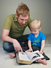 A father and son reading.