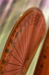 A semi-opaque, plastic red protractor and ruler.